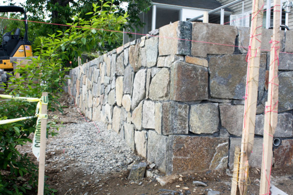 stone wall being built