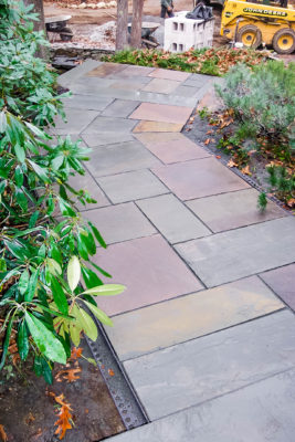front paved walkway with natural stone