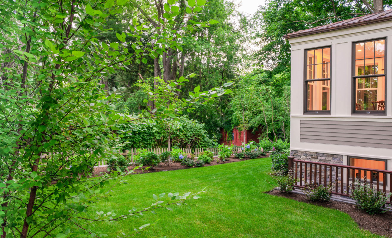 backyard with lawncare for newton property