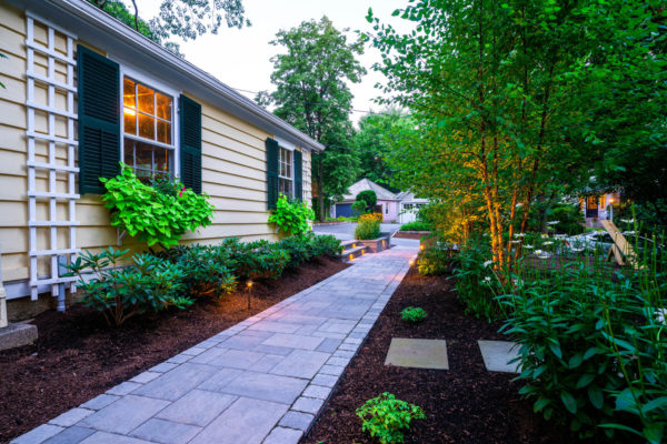 side walkway with outdoor lighting