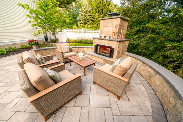 Outdoor lounge area with fireplace.